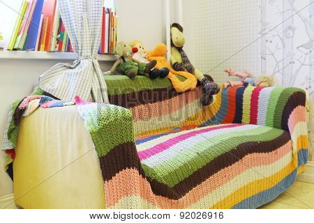 The sofa in the children's room with colorful plaid