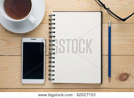 Cup Of Coffee With Books On The Wooden Table