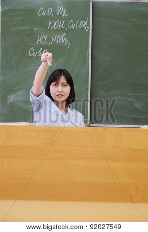 The image of a girl teacher in a class