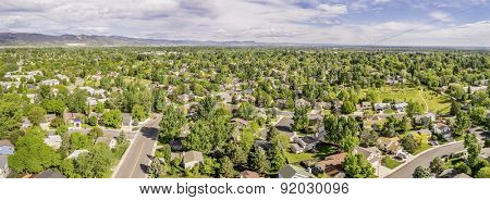 FORT COLLINS, CO, USA - May 28, 2015: Aerial panorama of Fort Collins with downtown and Rocky Mountains in a distance, late spring scenery