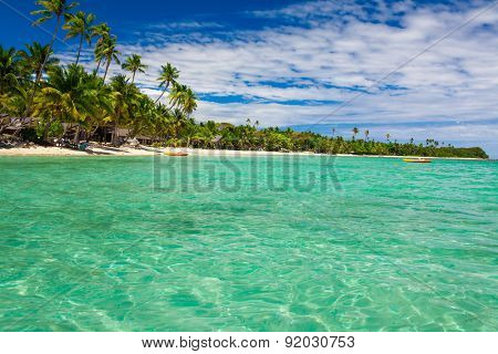 Coconut palm trees over tropical lagoon on Fiji Islands