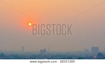 Hazy Skyline Of Chiang Mai City ,thailand  Smog Covering Buildings With Sunrise.
