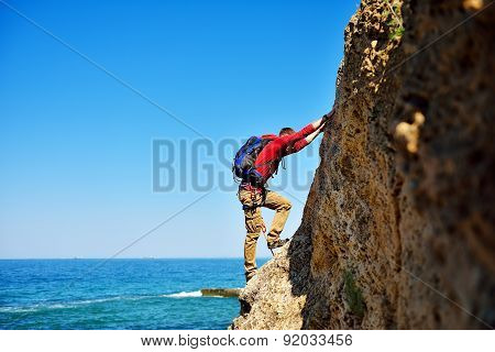 Climber Climbing On Mountain