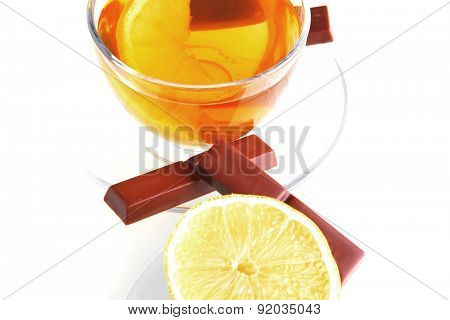 sweet health dessert - light green tea with lemon and chocolate strips isolated over white background