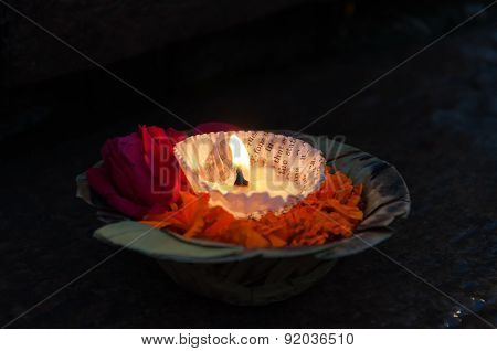 Flowers And Candle For Ganga Aarti Ritual