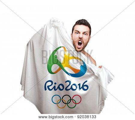 RIO DE JANEIRO, BRAZIL - CIRCA MAY 2015: Man holding Rio 2016 flag on white background