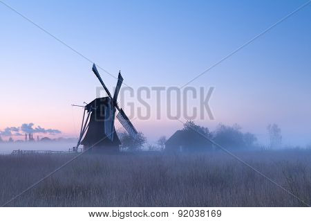 Charming Windmill In Sunrise Fog