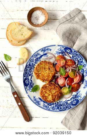Zucchini Patties And Fresh Salad In A Vintage Plate On A White Surface