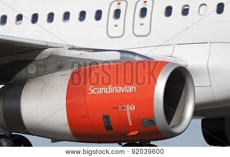 Orange engine of a boeing plame