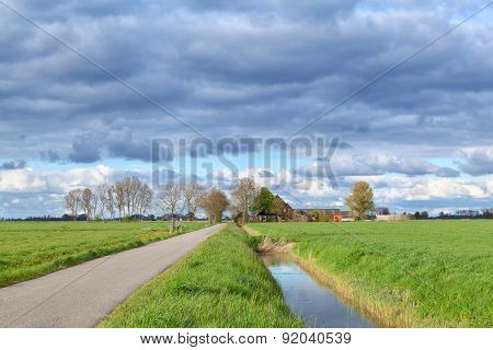 Dutch Farmland With Clouded Sky