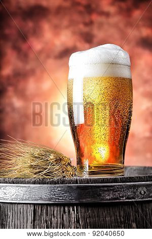 Glass of beer with wheat ears