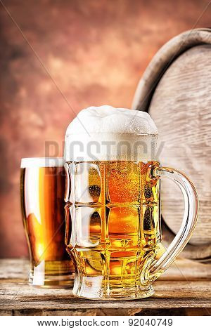 Mug and a glass of beer with keg
