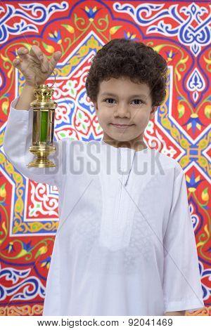 Smiling Young Boy With Lantern Celebrating Ramadan