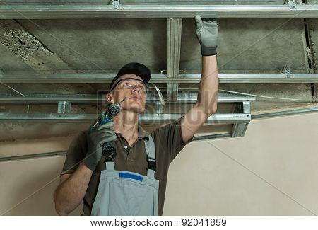 Worker Assembles Metal Frame