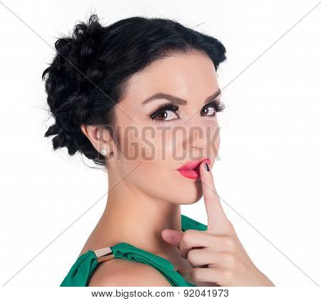 Pretty woman making a keep it quiet gesture