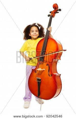 Beautiful African girl holds cello and fiddlestick
