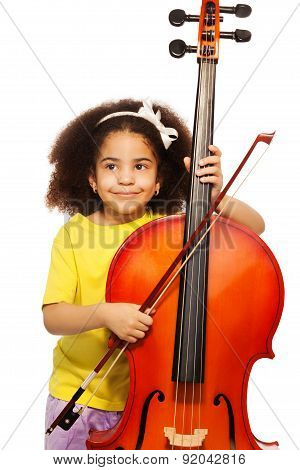 African girl holding violoncello and playing