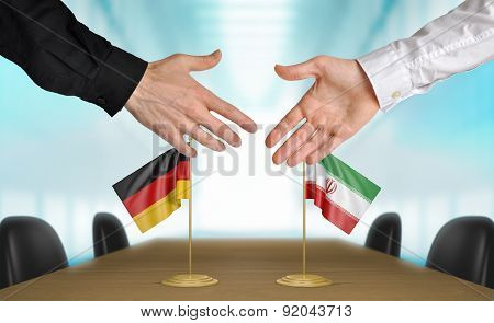 Germany and Iran diplomats agreeing on a deal