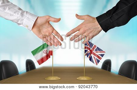 Iran and United Kingdom diplomats agreeing on a deal