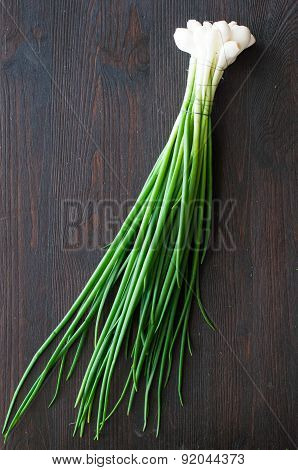 Fresh Spring Onion On A Wooden Background