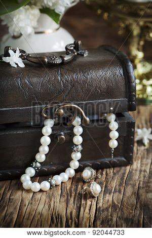 Still Life With Treasure Chest And Pearl Necklaces.