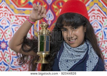Happy Young Girl With Fez And Lantern Celebrating Ramadan