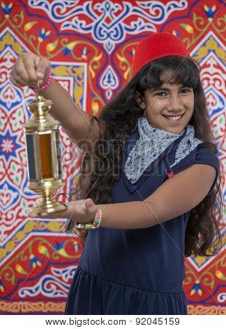 Happy Young Girl Holding Ramadan Lantern