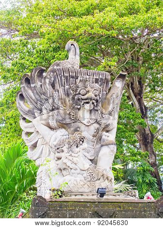 Traditional balinese sculpture near entrance to the temple