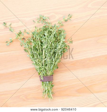 Fresh Thyme On A Light Wooden Background