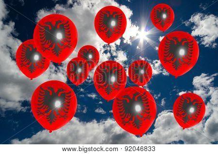 Many Balloons With Albania Flag On Sky