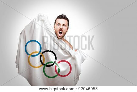 RIO DE JANEIRO, BRAZIL - CIRCA MAY 2015: Man holding Olympic Games flag on white background