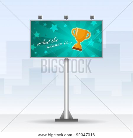Outdoor billboard with winners cup