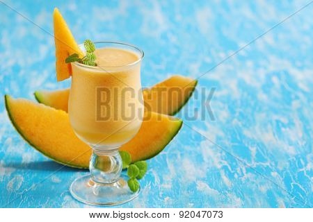 Melon Drink In Glasses With Slices Of Melon And Mint.