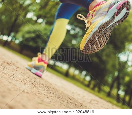 Runner running outdoors wearing sport leggings