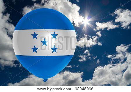 Balloon With Flag Of Honduras On Sky