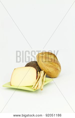 Dark And Light Breads With Gouda Cheese On White Background