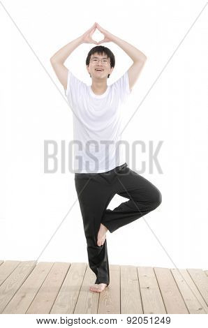 Full body Young Asian man yoga on wooden floor isolated