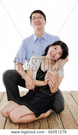 Loving couple embracing on wooden floor