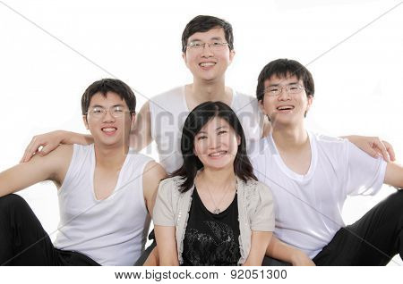 portrait of four asian happy family isolated on white background