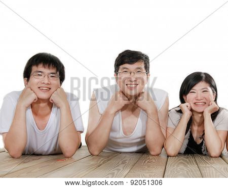 Indoor portrait of asian family lying on