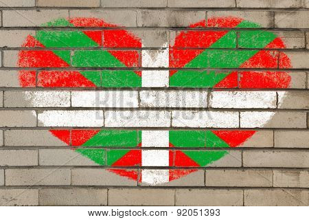 Heart Shape Flag Of Basque On Brick Wall