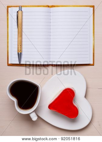 Coffee Cup Cake In Heart Form And Notebook