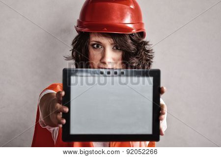 Sexy Girl In Safety Helmet Showing Tablet