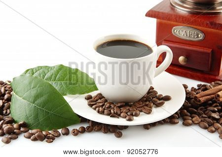 Scattered Coffee Beans With Cups Of Coffee And Leaf