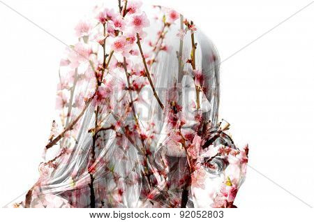 Double exposure photo of flowering branches and girl smelling perfume