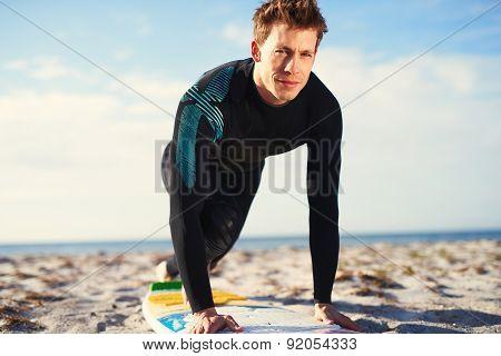 Male Surfer In Proper Pop Up Balance On Surfboard