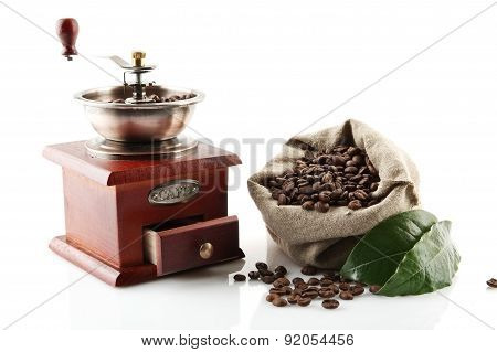 Sack Full Of Coffee Beans With Green Leaves With Mill