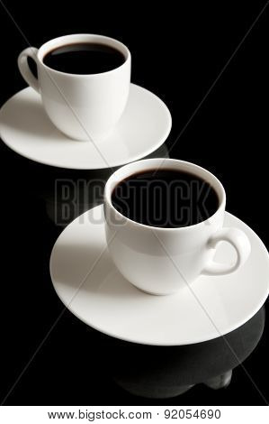 Cups Of Coffee With Saucer Isolated On Black