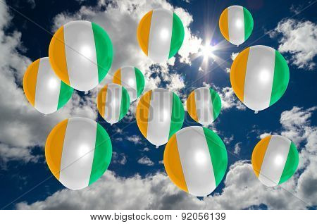 Many Balloons With Ivory Coast Flag On Sky
