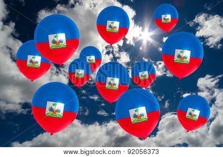 Many Balloons With Haiti Flag On Sky